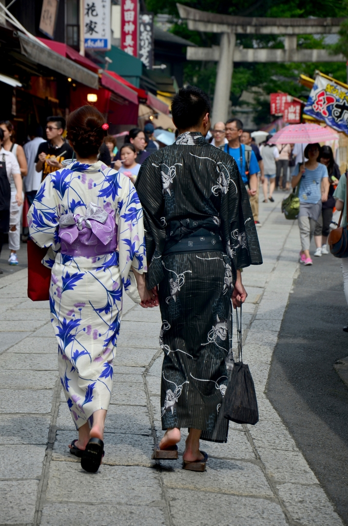 Kyoto, Japan - July 11, 2015: Japanese people wear traditional Japanese clothing (Kimono and Yukatas) walking to inside at Fushimi Inari Shrine in Kyoto, Japan