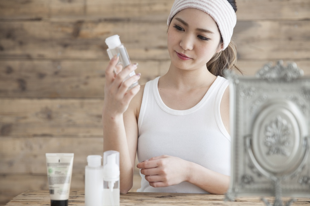 Young women are looking at the components of the lotion