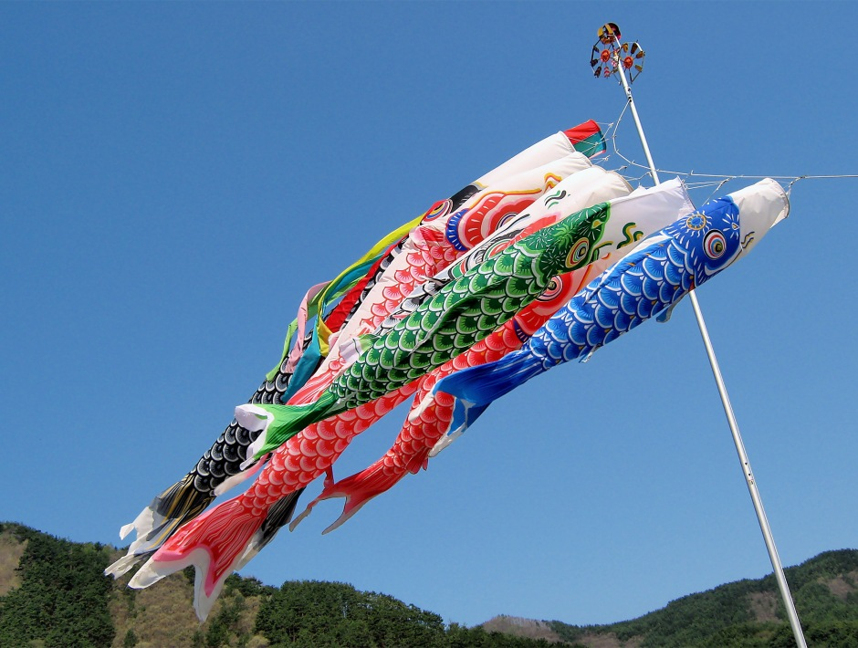 Carp streamers blue sky mountains